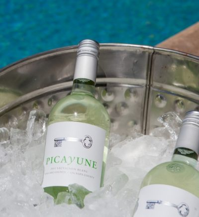 Picayune Sauvignon Blanc by the pool in ice bucket