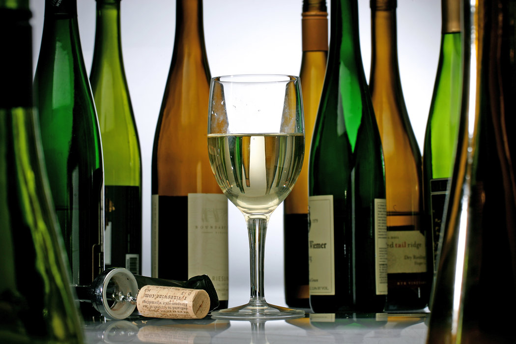 glass of riesling with riesling titles