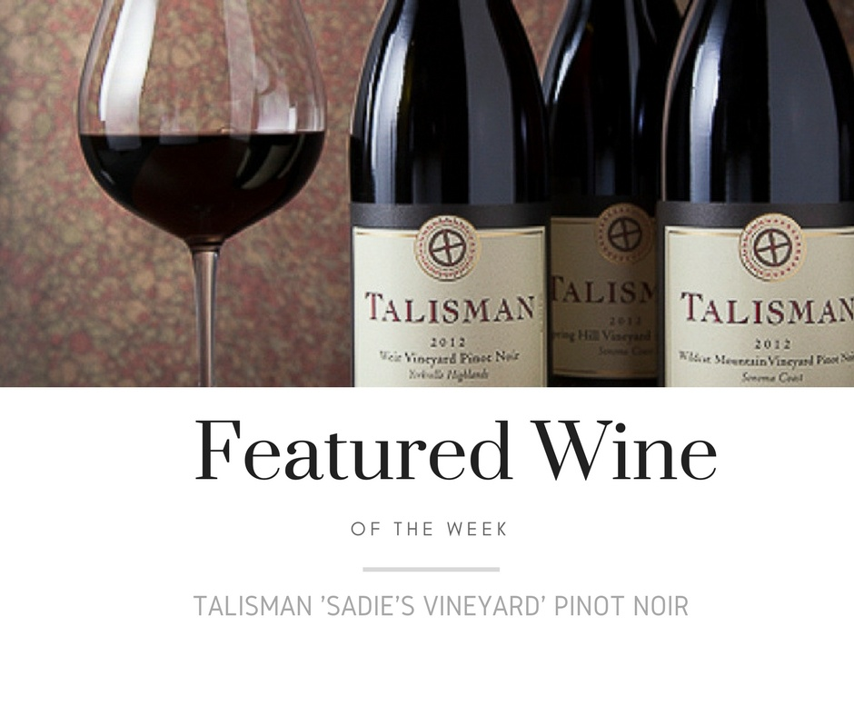 featured wine with wine glass and bottles