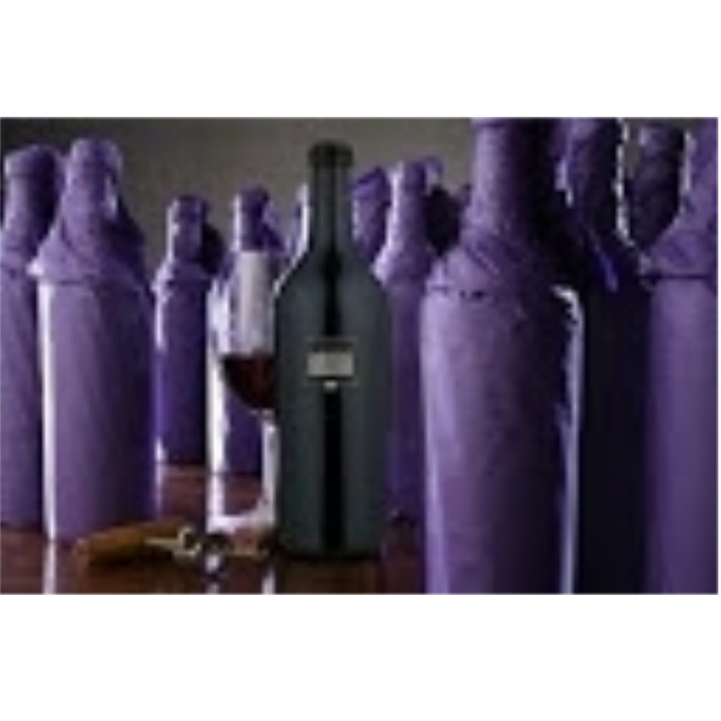 covered wine bottles with wine bottle and glass